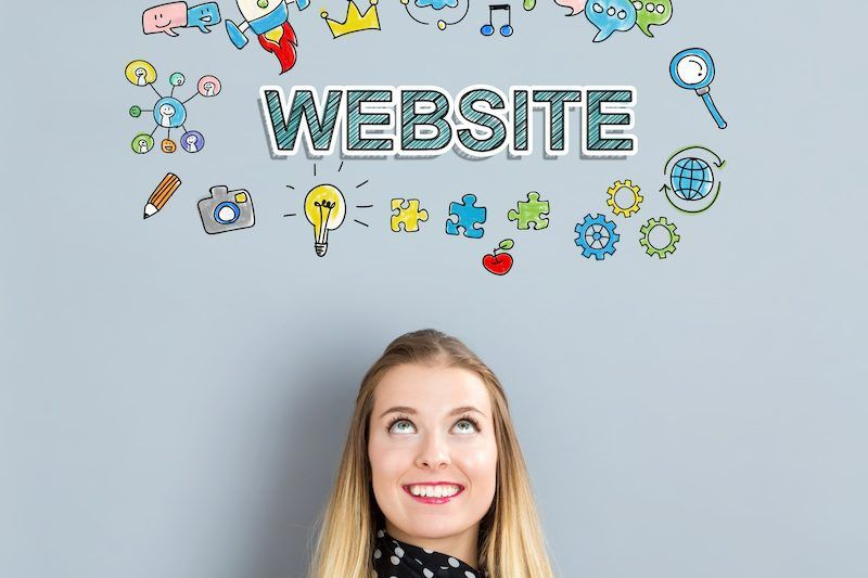 Website concept with happy young woman on a gray background